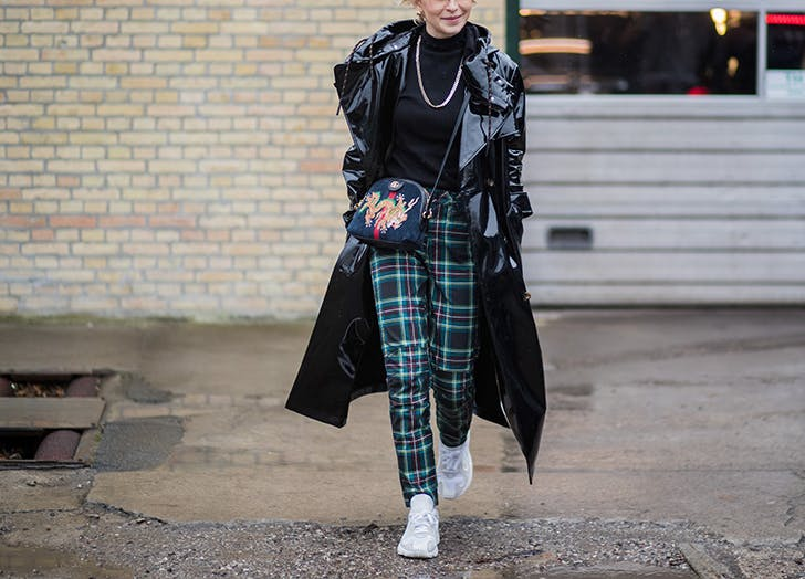 woman wearing plaid pants and sneakers