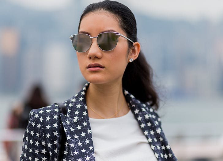 woman wearing ponytail diamond earrings and sunglasses