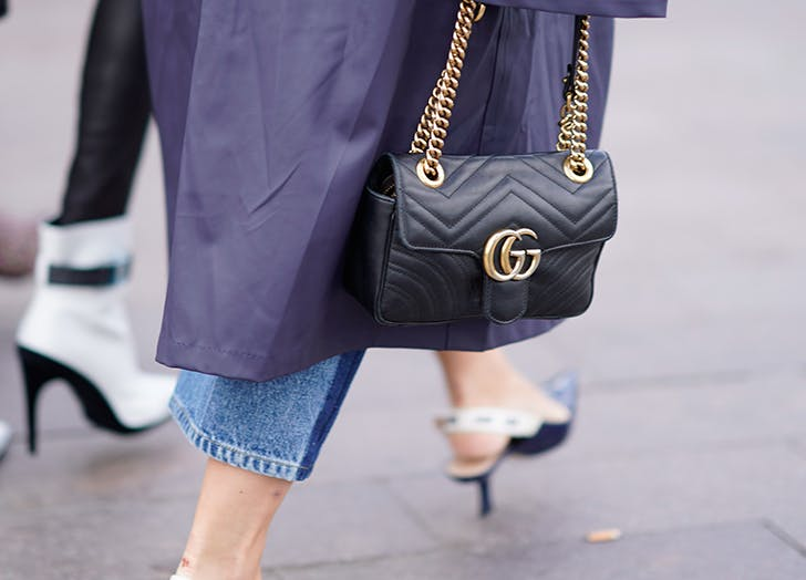 woman wearing slingback heels and black gucci bag