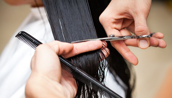 woman getting her hair trimmed