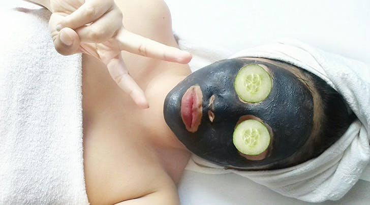 woman wearing face mask at a spa