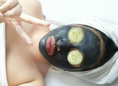woman wearing face mask at a spa 400