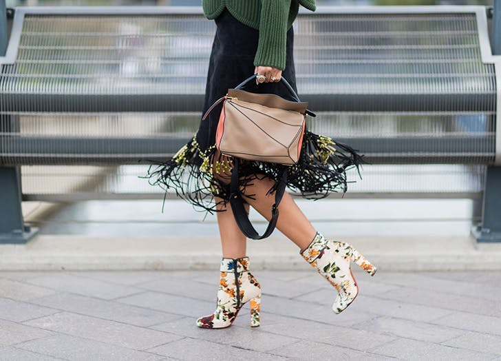woman wearing fringe skirt and floral booties
