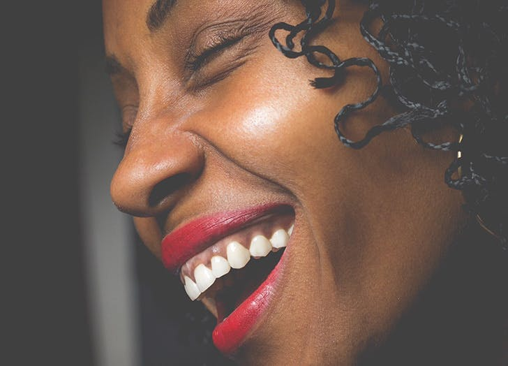 woman with red lipstick laughing