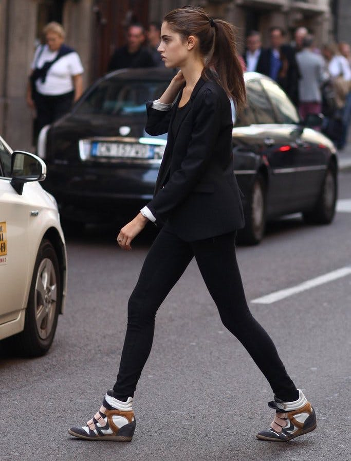 young woman wearing wedge sneakers at milan fashion week 2013