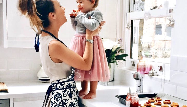 2 mom and her daughter baking cookies