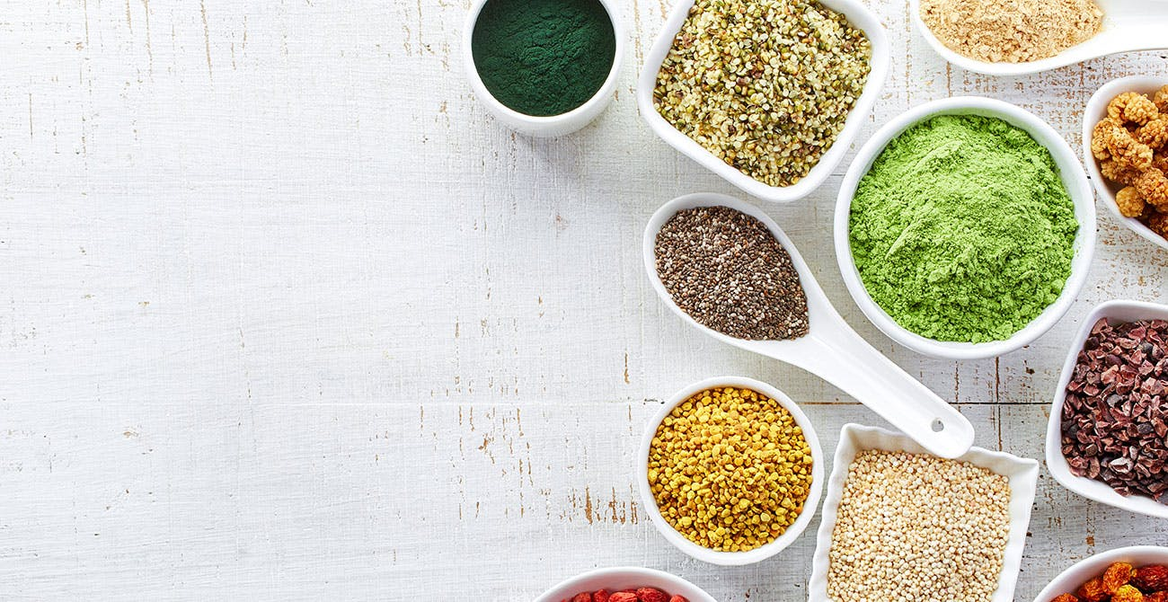 Bowls with different adaptogenic powders and herbs
