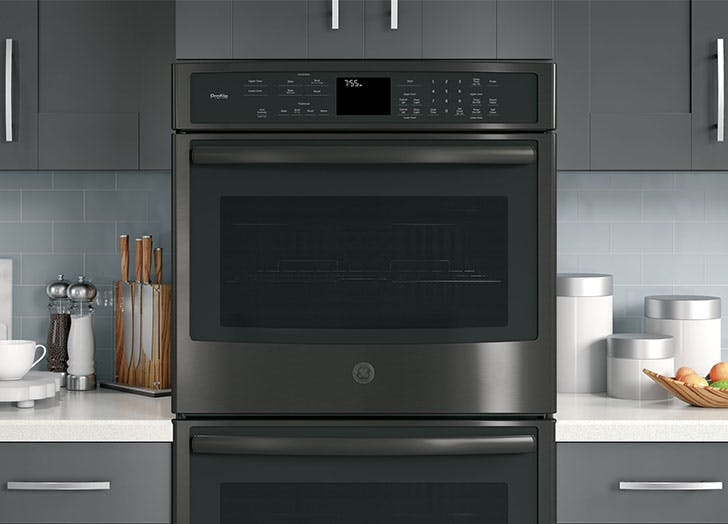 GE black stainless steel stacked ovens
