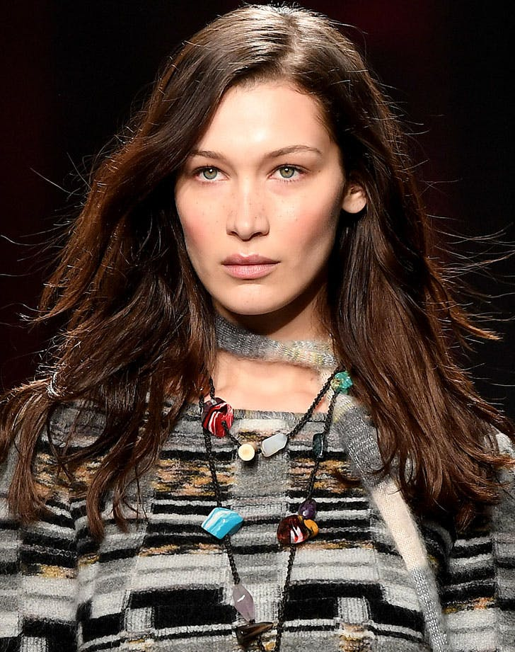 Model Bella Hadid wearing crystals around her neck