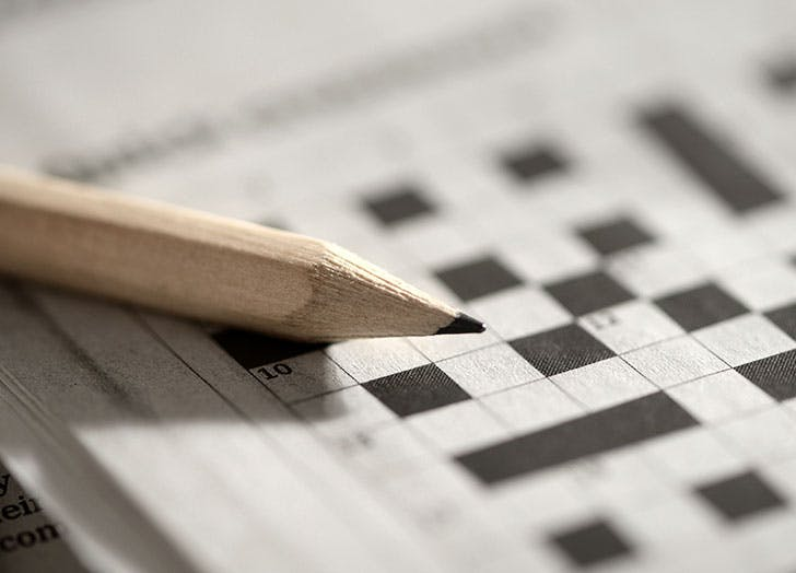 Pencil and crossword puzzle