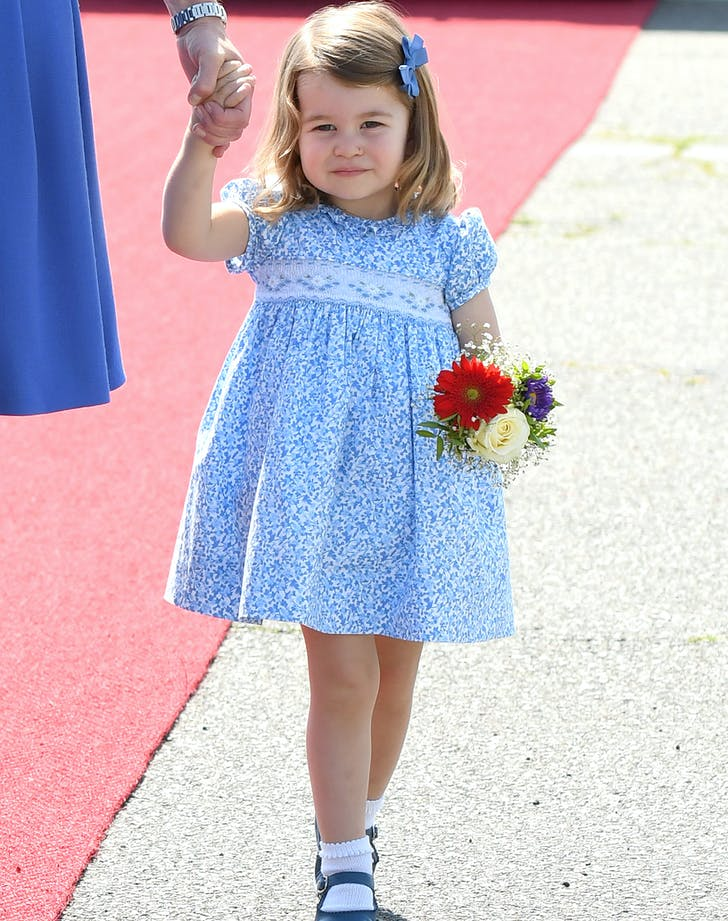 Princess Charlotte walking with flowers