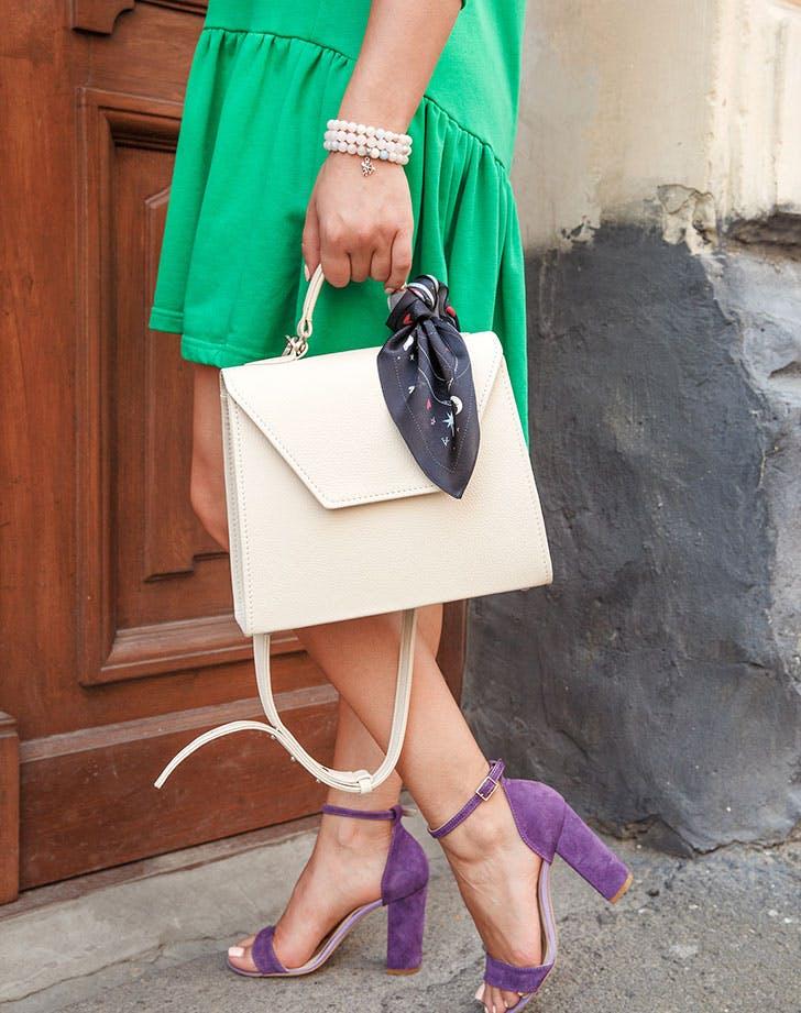 Silk scarf tied around purse trend