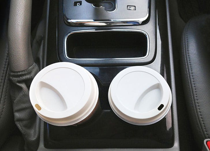 Takeaway coffee cups in car