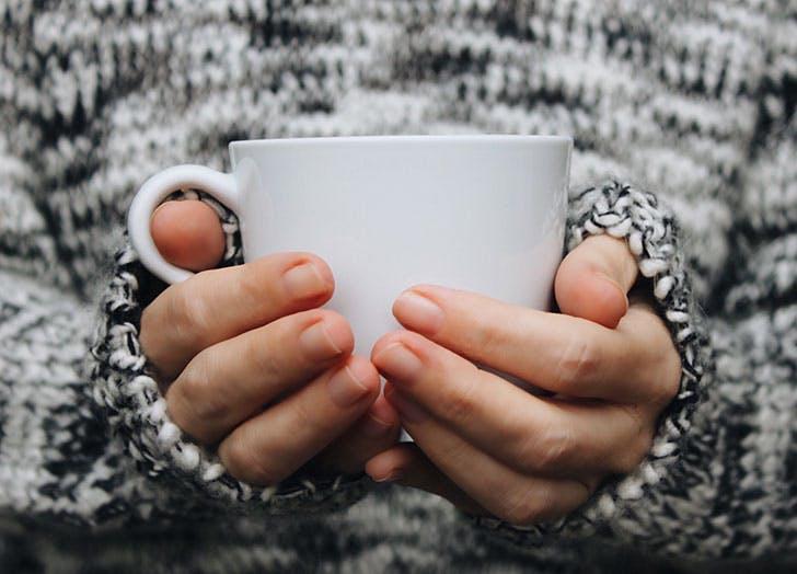 Woman holidng mug of tea