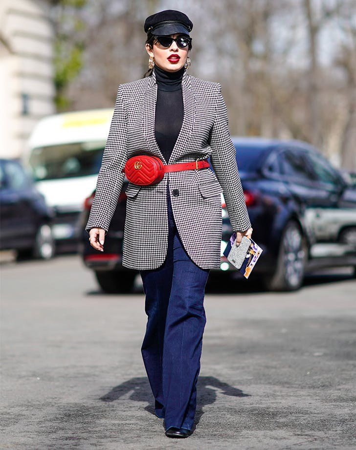 Woman Wearing red gucci bet bag