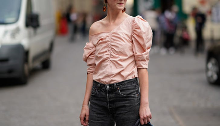 Woman wears ruched blouse