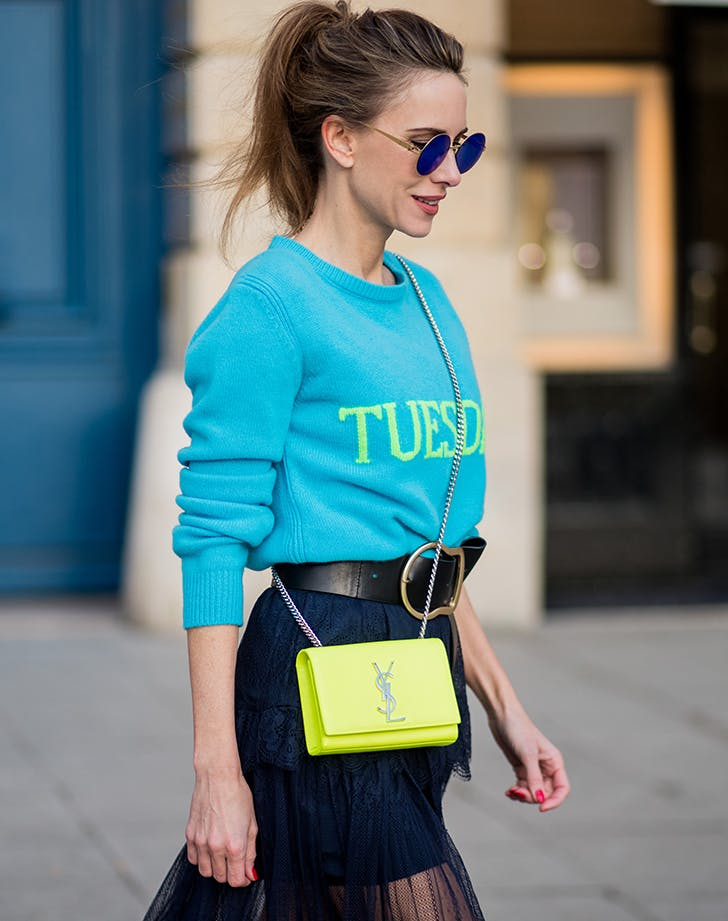 a neon handbag adds the perfect pop of color