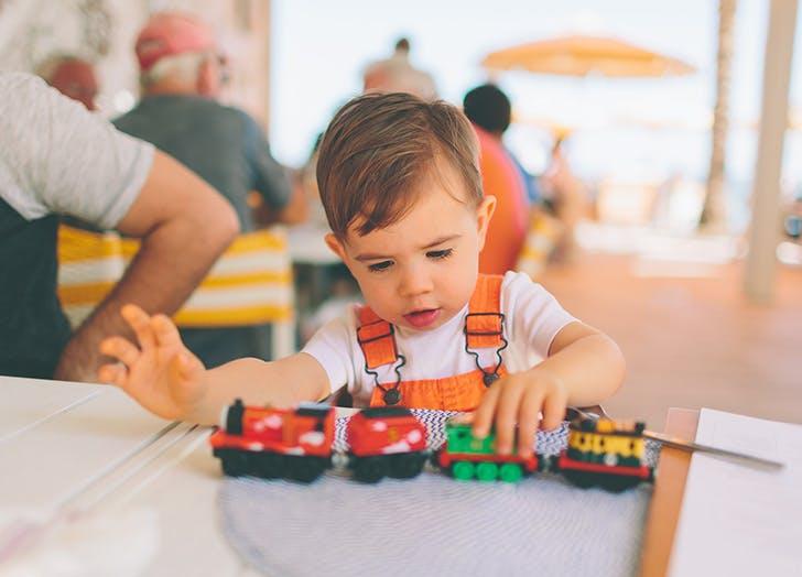 boy playing trains