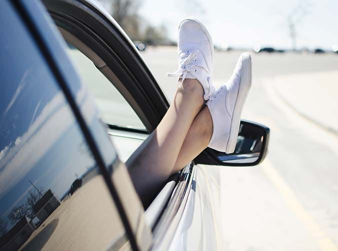 feet out  car window