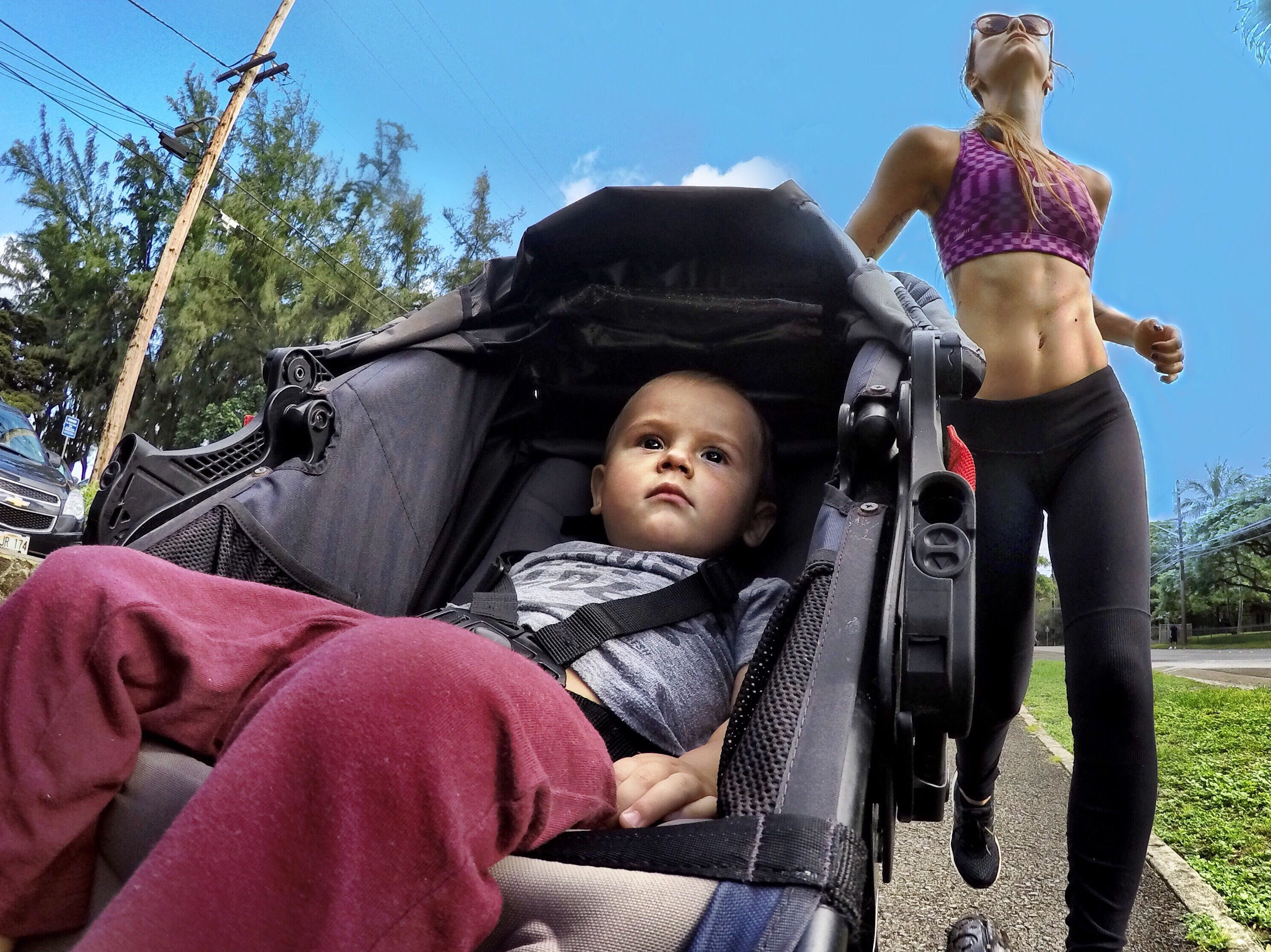 fit mom running with her kid in a stroller
