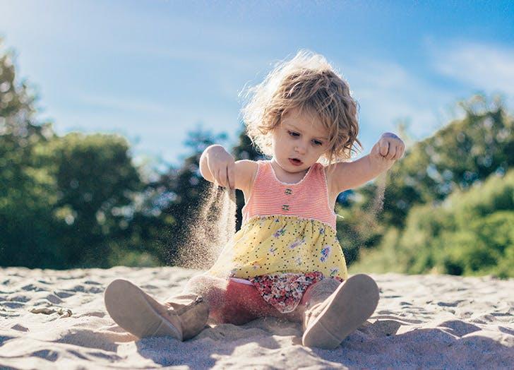 girl playing the sand