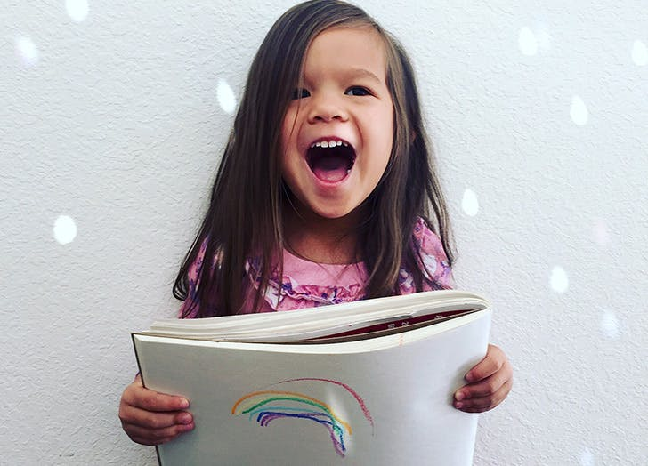 happy girl with coloring book