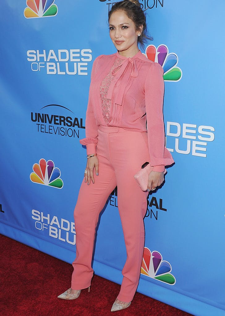 jennifer lopez wearing a pink shirt and pants