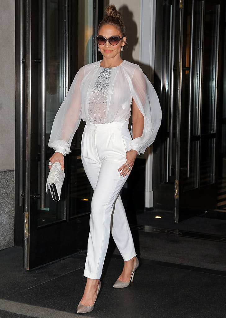 jennifer lopez wearing a white top and pants