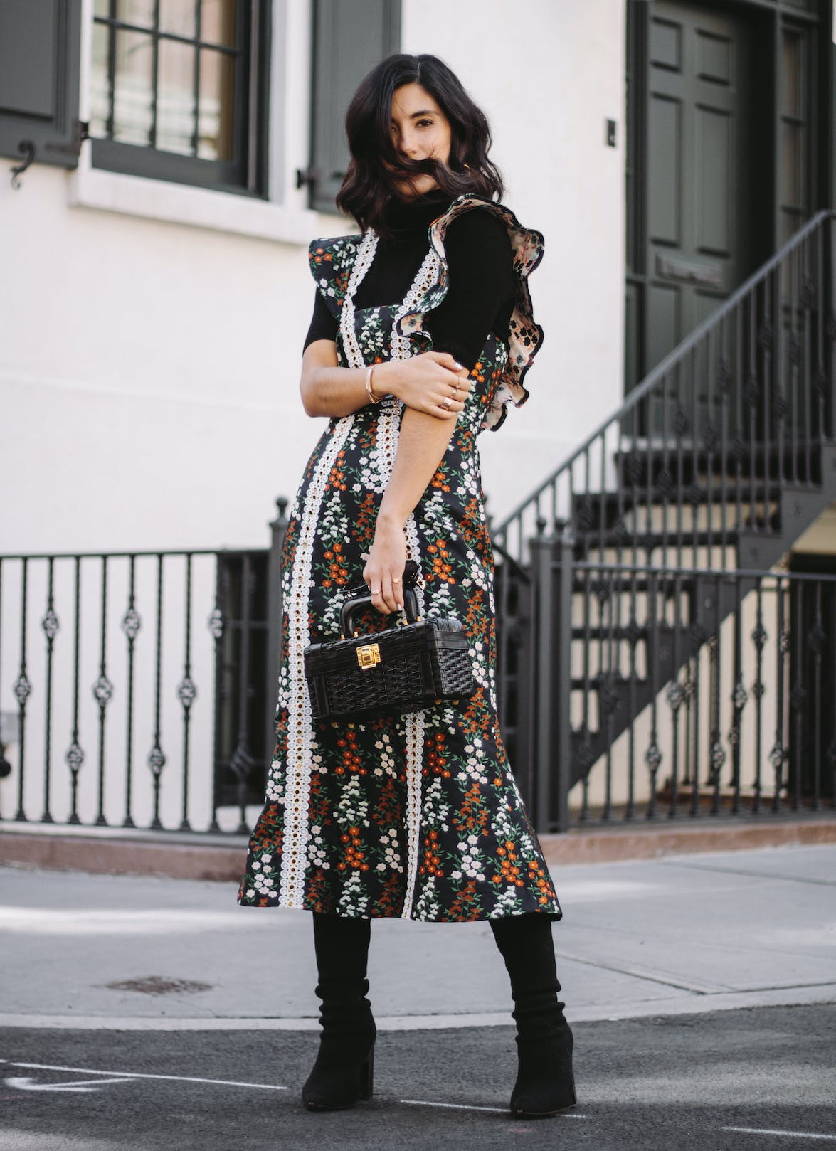 layer a ruffled sun dress over boots and a turtleneck