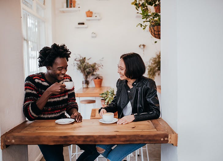man and woman drinking coffee together