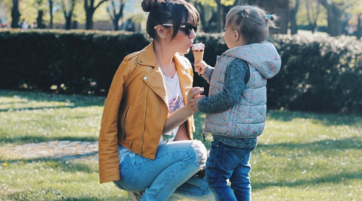 nanny eating ice cream with a little girl