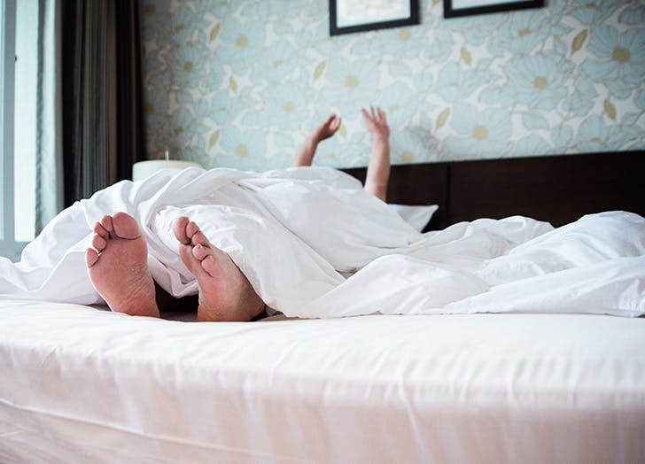 person stretching out in bed