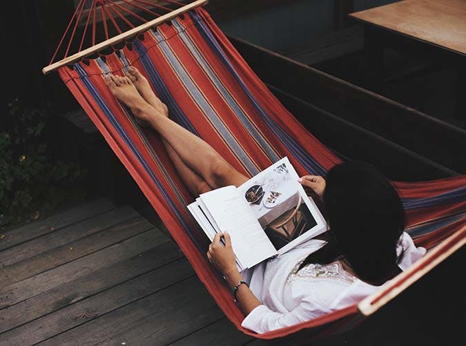 reading magazine hammock
