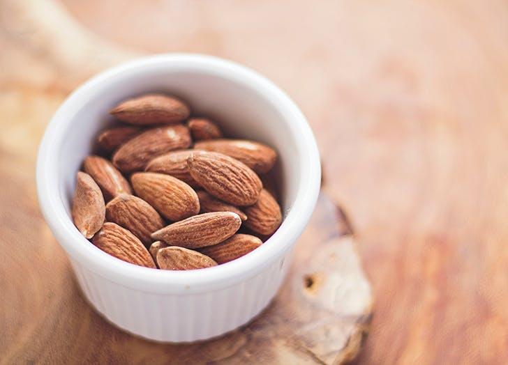 small white bowl filled with almonds