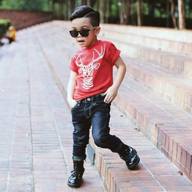 super stylish little boy striking a pose
