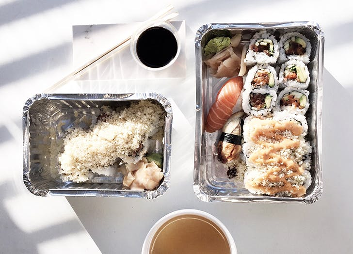 sushi and soup in takeout containers