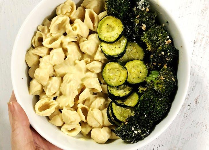 white bowl with vegan cauliflower mac and cheese