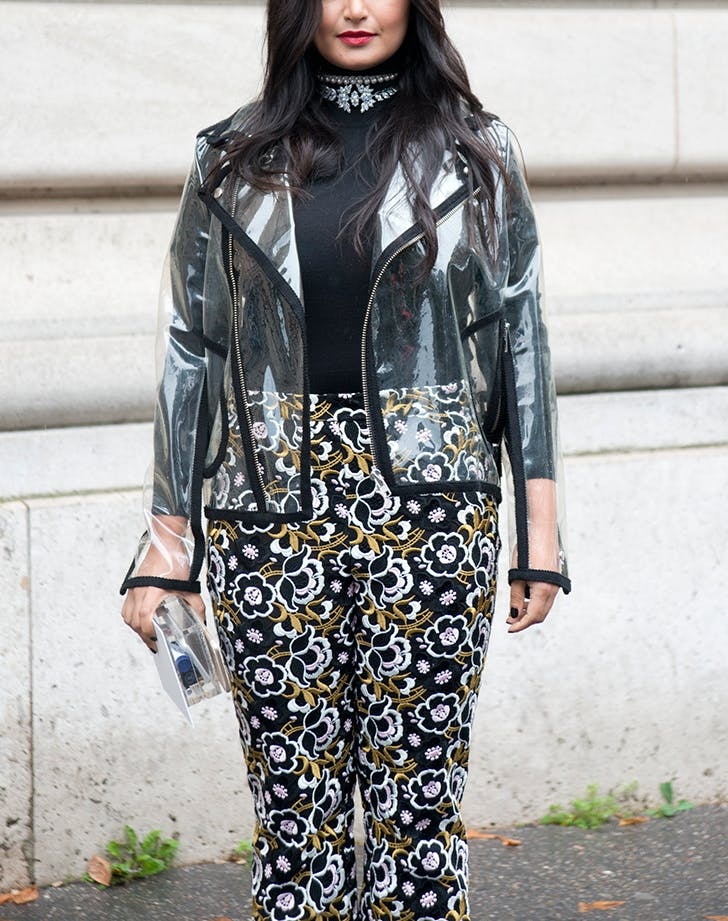 woman wearing a pvc jacket and printed pants