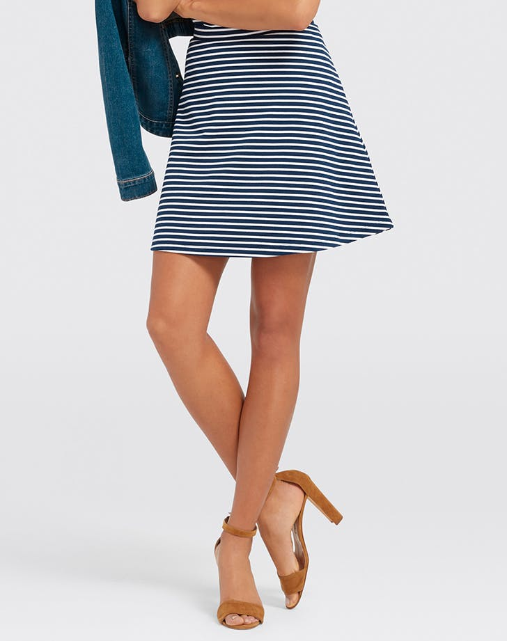 woman wearing a striped miniskirt