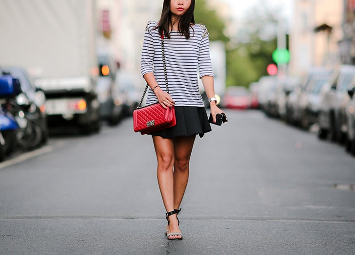woman wearing a striped shirt and short black skirt