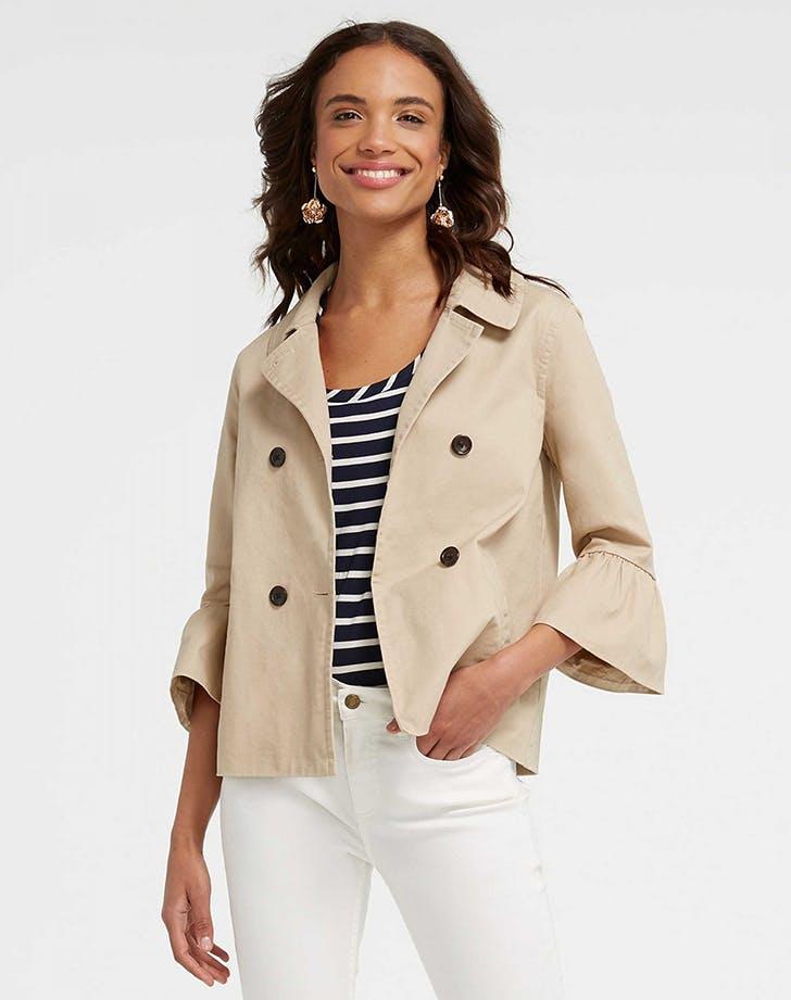 woman wearing a tan jacket