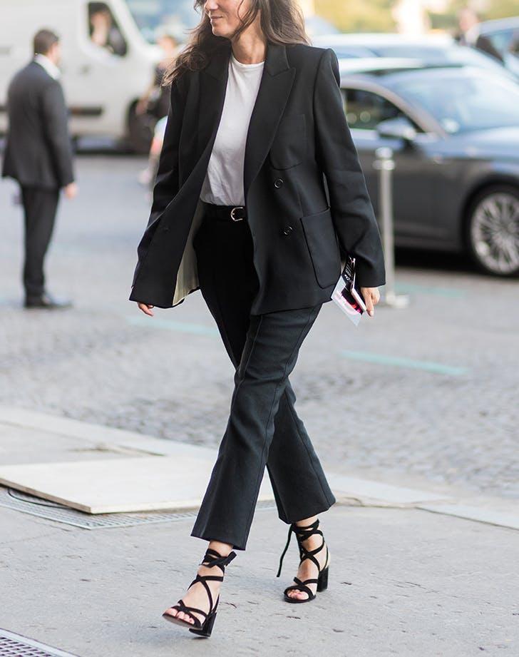 woman wearing a white shirt black blazer and pants