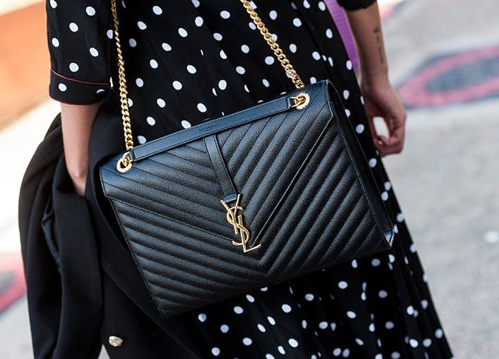 woman wearing black polka dot dress and black ysl bag