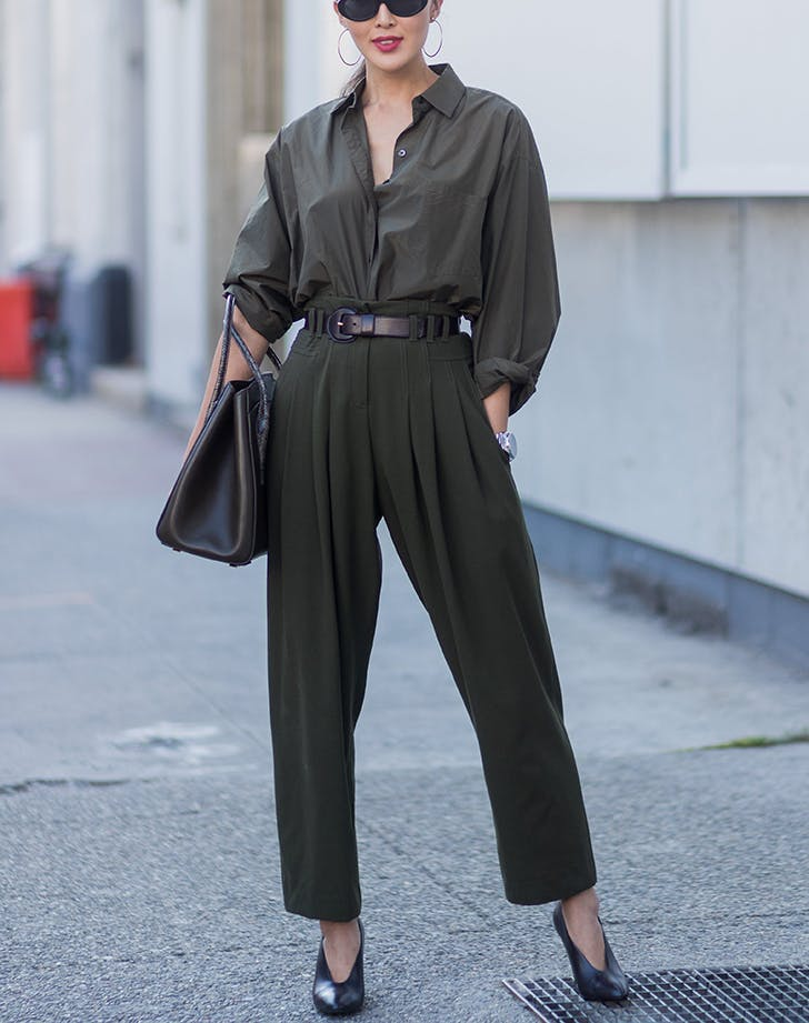 woman wearing green pants and top with belt