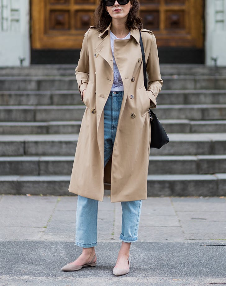 woman wearing jeans ballet flats and a trench coat