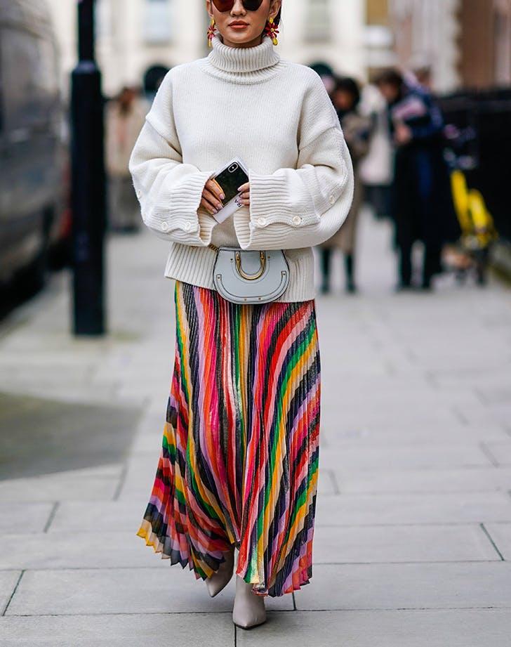 woman wearing printed skirt and turtleneck