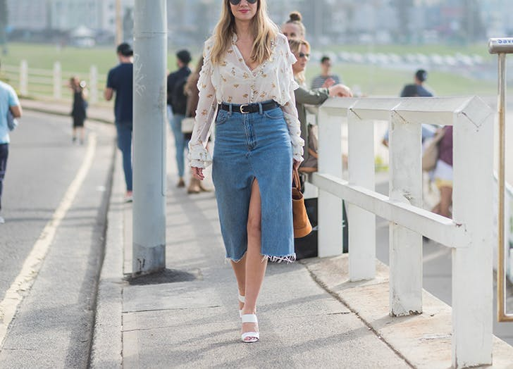 woman wearing ruffled blouse and denim pencil skirt