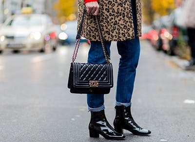 woman holding chanel bag cat