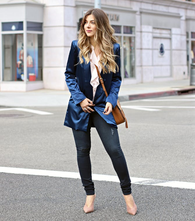 woman wearing a satin blazer and jeans