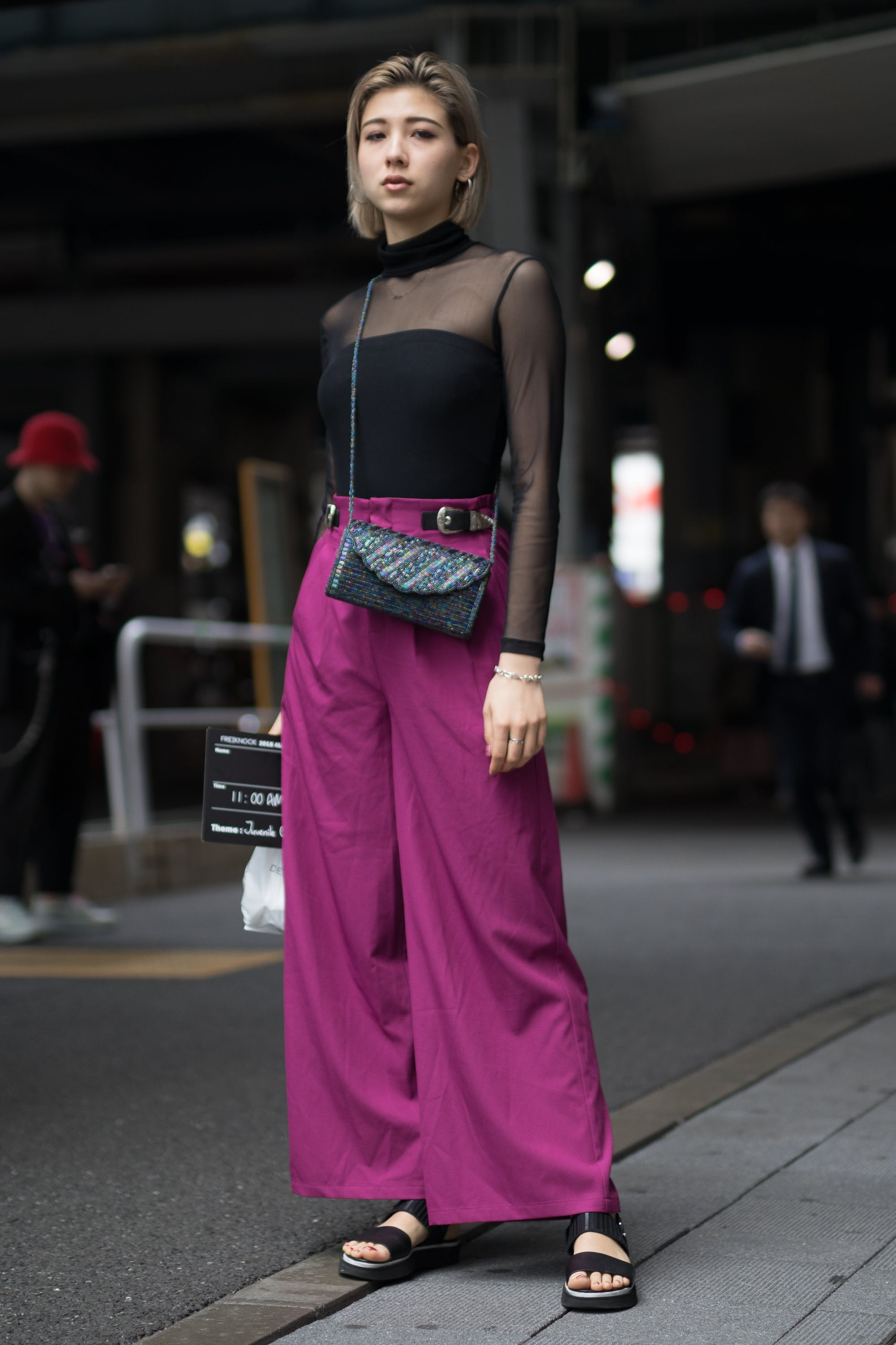 woman wearing black sweater and purple pants